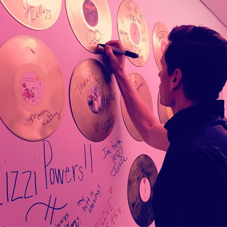 man signing record